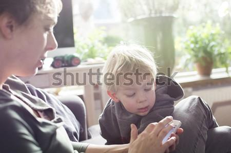 Mother and child using smartphone